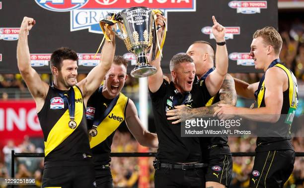 Trent Cotchin of the Tigers and Damien Hardwick, Senior Coach of the Tigers hold the cup aloft during the 2020 Toyota AFL Grand Final match between...