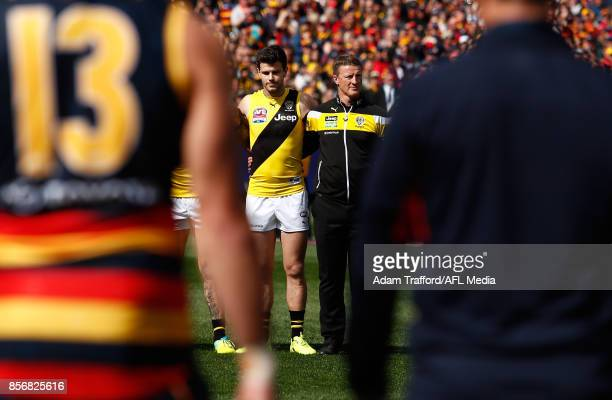Trent Cotchin of the Tigers and Damien Hardwick Senior Coach of the Tigers line up for the national anthem during the 2017 Toyota AFL Grand Final...