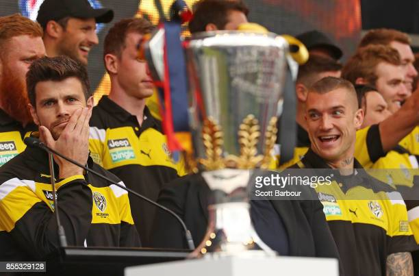 Trent Cotchin of the Tigers and Dustin Martin of the Tigers look towards the Premiership Cup as it sits on stage during the 2017 AFL Grand Final...
