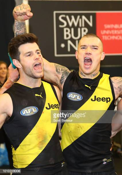 Trent Cotchin of the Tigers and Dustin Martin of the Tigers sing the song in the rooms after winning during the round 20 AFL match between the...