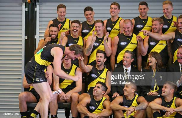Trent Cotchin of the Tigers and his teammates laugh at Dylan Grimes after he had a sign stuck to his back during a Richmond Tigers AFL team photo...