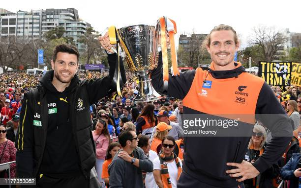 Trent Cotchin of the Tigers and Phil Davis of the Giants hold up the Premiership Trophy during the 2019 AFL Grand Final Parade on September 27, 2019...