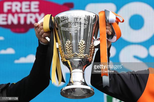 Trent Cotchin of the Tigers and Phil Davis of the GWS Giants pose with the Premiership Cup during the 2019 AFL Grand Final Parade on September 27,...