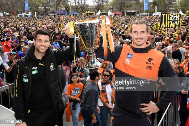 Trent Cotchin of the Tigers and Phil Davis of the GWS Giants pose with the Premiership Cup during the 2019 AFL Grand Final Parade on September 27...