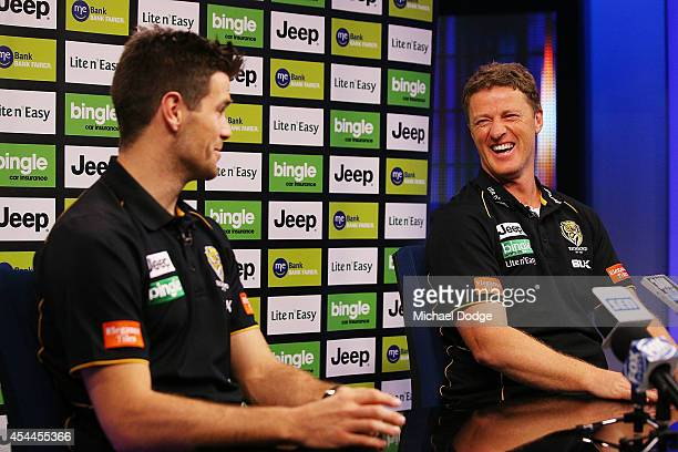 Trent Cotchin of the Tigers and Tigers coach Damien Hardwick react to the media during the AFL Finals Series Launch at Fox Footy on September 1, 2014...