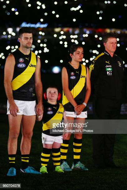Trent Cotchin of the Tigers and Tigers head coach Damien Hardwick stand in line for a minutes silence during the ANZAC observance during the 2018 AFL...