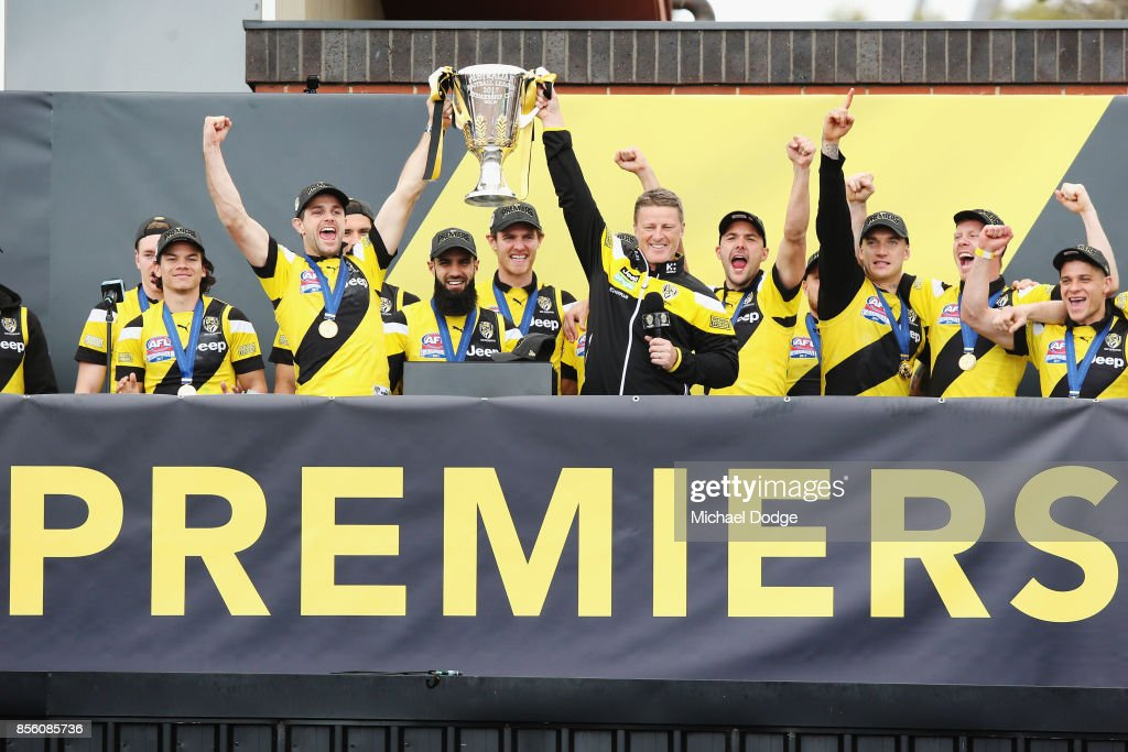 Trent Cotchin of the Tigers and Tigers head coach Damien Hardwick lift up the Premiership cup as players celebrate winning yesterday's AFL Grand Final, at Punt Road Oval on October 1, 2017 in Melbourne, Australia.