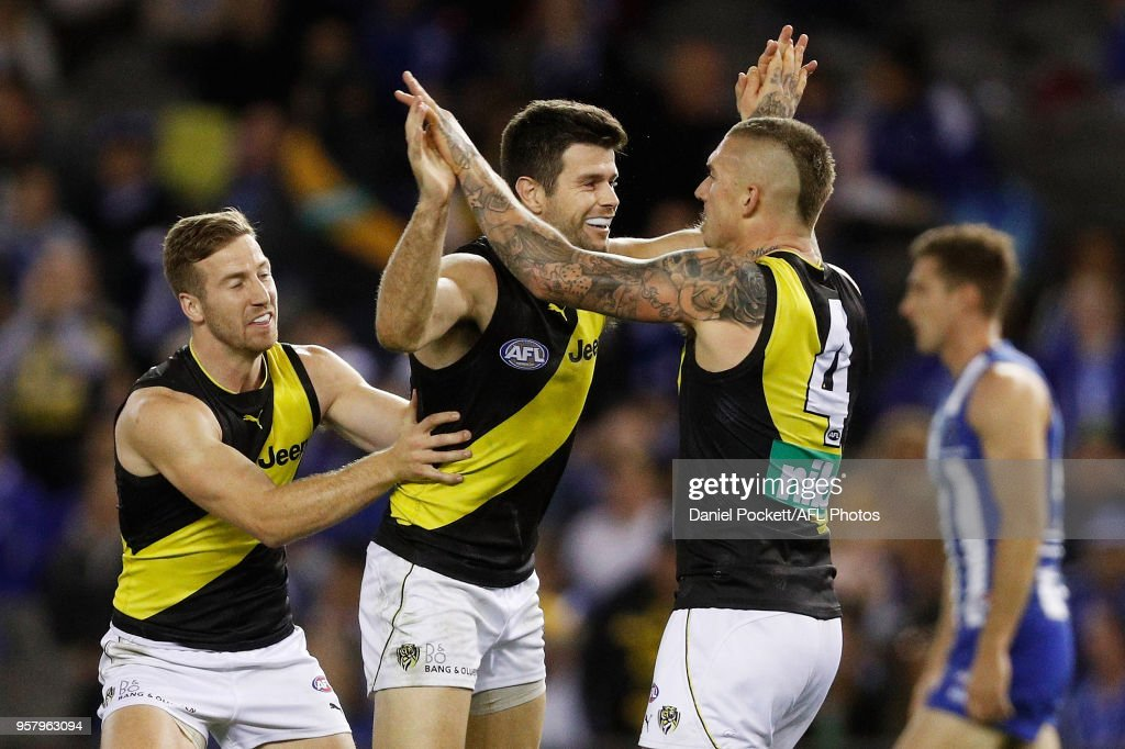 Trent Cotchin of the Tigers (2nd left) celebrates a goal during the 2018 AFL round eight match between the North Melbourne Kangaroos and the Richmond Tigers at Etihad Stadium on May 13, 2018 in Melbourne, Australia.