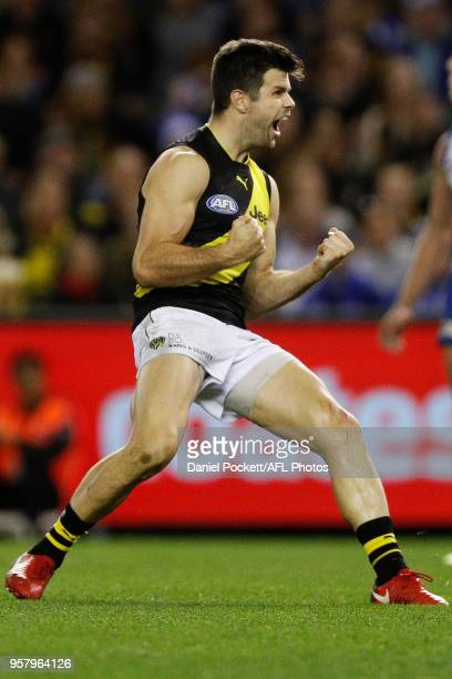 Trent Cotchin of the Tigers celebrates a goal during the 2018 AFL round eight match between the North Melbourne Kangaroos and the Richmond Tigers at...
