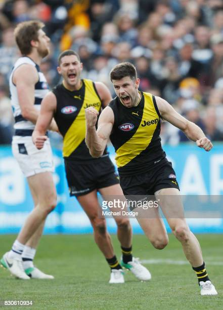 Trent Cotchin of the Tigers celebrates a goal during the round 21 AFL match between the Geelong Cats and the Richmond Tigers at Simonds Stadium on...