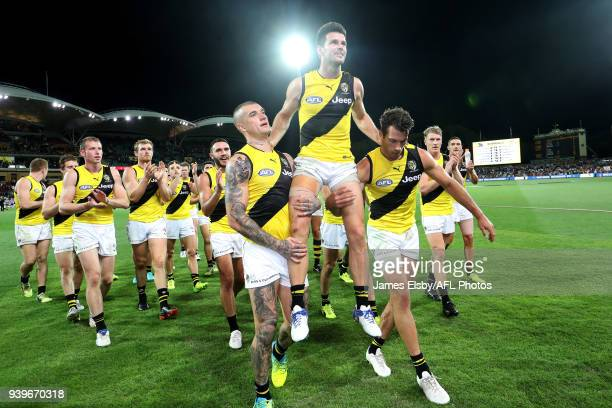Trent Cotchin of the Tigers celebrates his 200th game during the 2018 AFL round 02 match between the Adelaide Crows and the Richmond Tigers at...