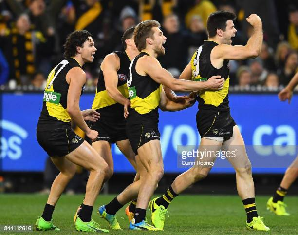 Trent Cotchin of the Tigers celebrates kicking a goal during the AFL Second Qualifying Final Match between the Geelong Cats and the Richmond Tigers...