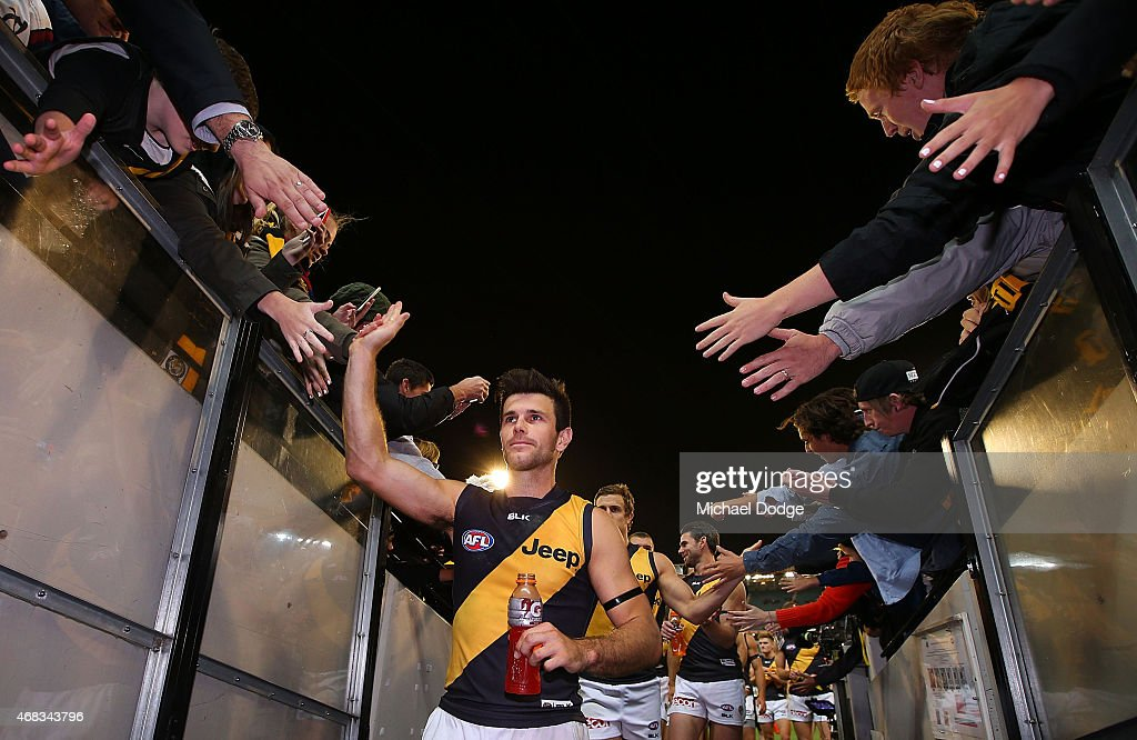 Trent Cotchin of the Tigers celebrates the win during the round one AFL match between the Carlton Blues and the Richmond Tigers at Melbourne Cricket Ground on April 2, 2015 in Melbourne, Australia.