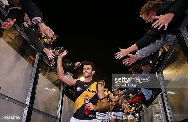 Trent Cotchin of the Tigers celebrates the win during the round one AFL match between the Carlton Blues and the Richmond Tigers at Melbourne Cricket...