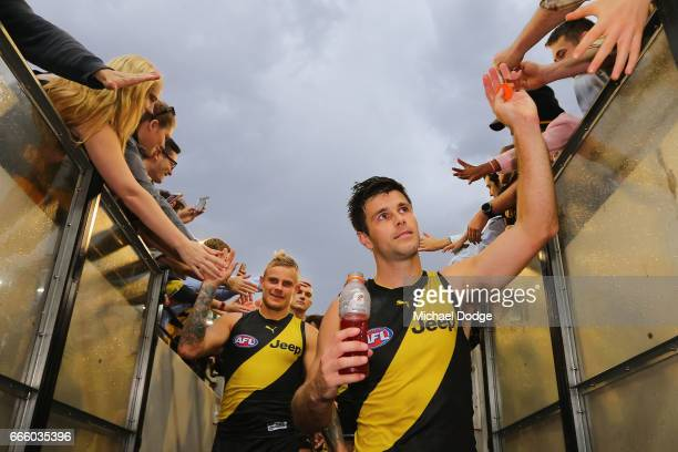Trent Cotchin of the Tigers celebrates the win with fans during the round three AFL match between the Richmond Tigers and the West Coast Eagles at...