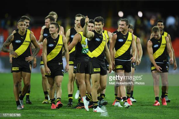 Trent Cotchin of the Tigers celebrates victory during the round 17 AFL match between the Geelong Cats and the Richmond Tigers at Metricon Stadium on...