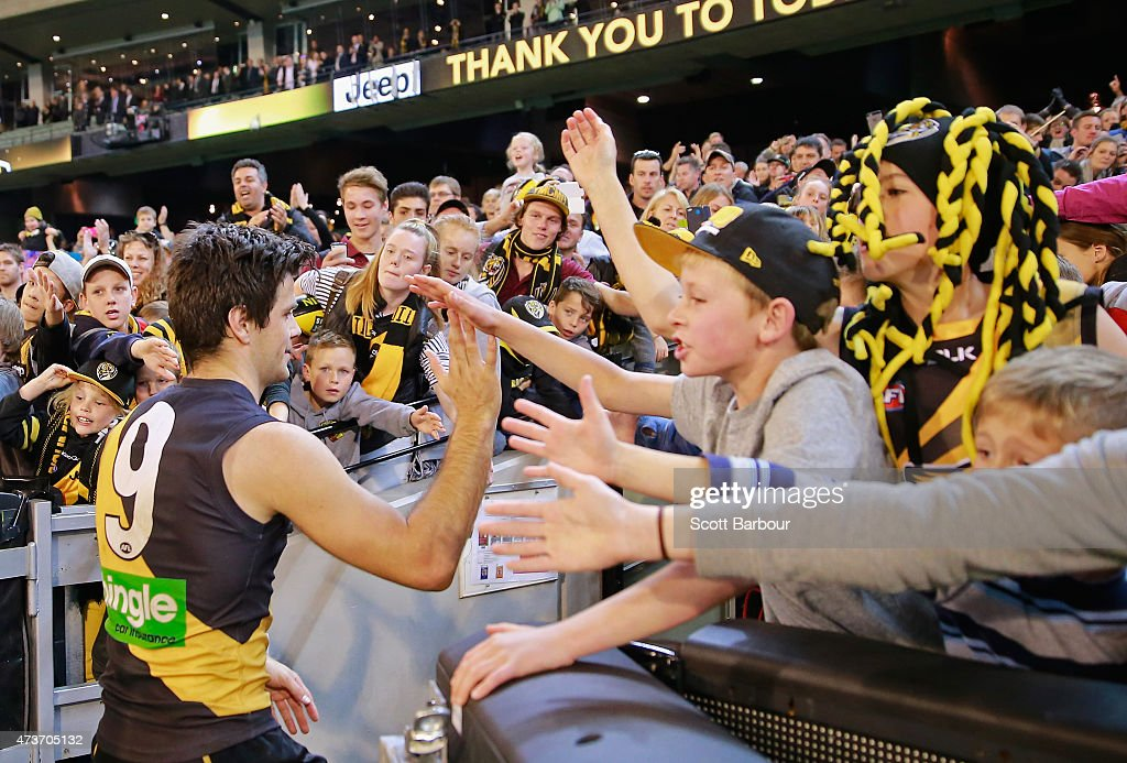 Trent Cotchin of the Tigers celebrates with supporters in the crowd after winning the round seven AFL match between the Richmond Tigers and the Collingwood Magpies at the Melbourne Cricket Ground on May 17, 2015 in Melbourne, Australia.