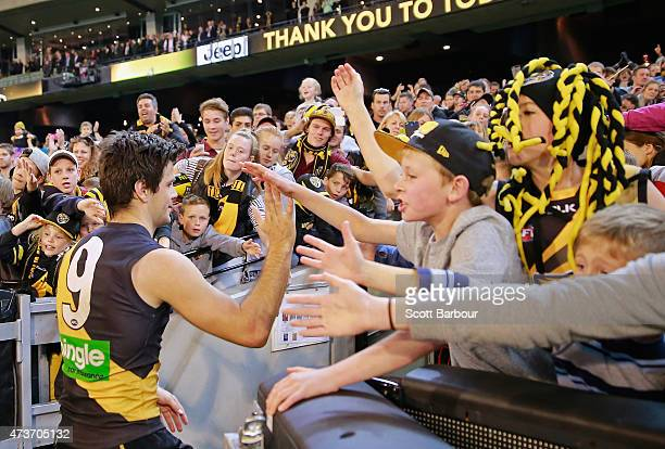 Trent Cotchin of the Tigers celebrates with supporters in the crowd after winning the round seven AFL match between the Richmond Tigers and the...