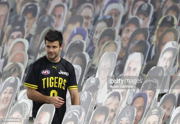 Trent Cotchin of the Tigers collects the ball amongst the Collingwood cardboard cut out fans the round 2 AFL match between the Collingwood Magpies...