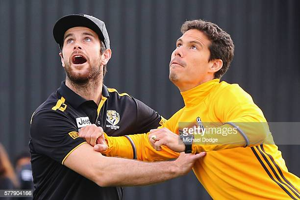 Trent Cotchin of the Tigers competes for an AFL football against Hernanes of Juventus during a Richmond Tigers AFL and Juventus FC media opportunity...