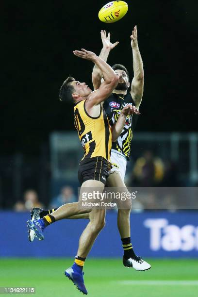 Trent Cotchin of the Tigers competes for the ball against Jaeger O'Meara of the Hawks during the 2019 JLT Community Series AFL match between the...
