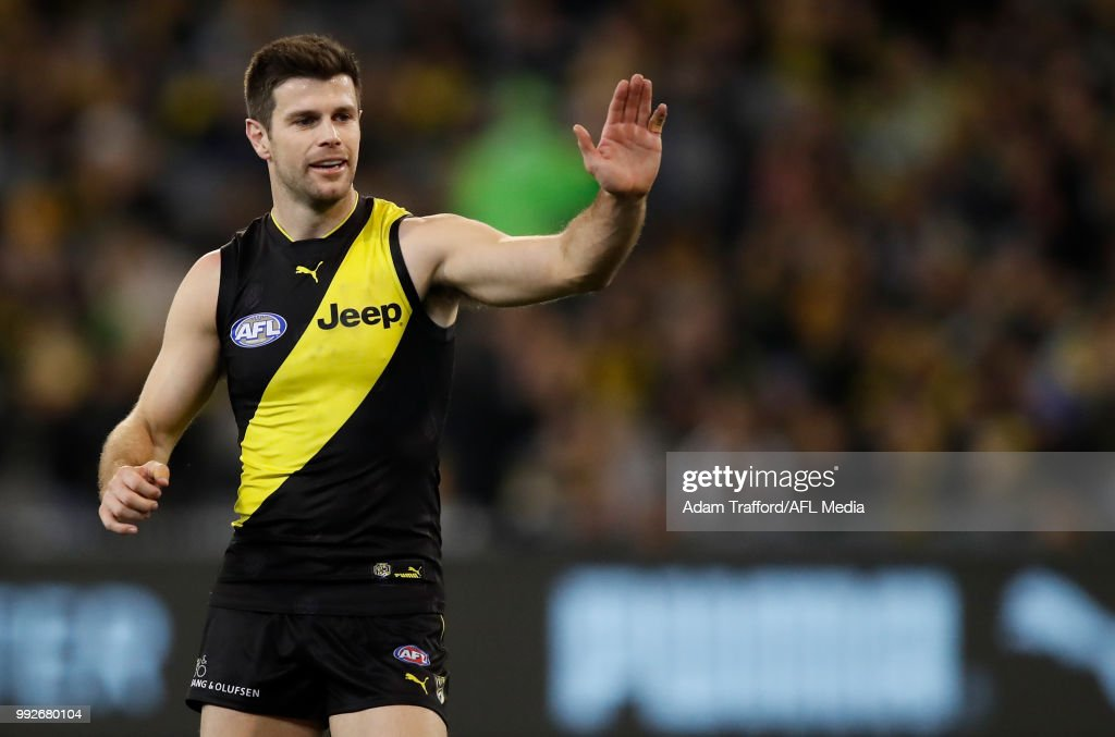 Trent Cotchin of the Tigers congratulates Jack Riewoldt of the Tigers on a goal during the 2018 AFL round 16 match between the Richmond Tigers and the Adelaide Crows at the Melbourne Cricket Ground on July 06, 2018 in Melbourne, Australia.