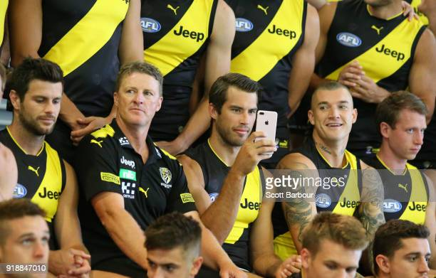 Trent Cotchin of the Tigers Damien Hardwick coach of the Tigers Alex Rance of the Tigers Dustin Martin of the Tigers and Dylan Grimes look on during...
