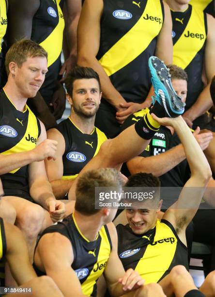Trent Cotchin of the Tigers has his leg lifted in the air by Patrick Naish during a Richmond Tigers AFL team photo session at Punt Road Oval on...