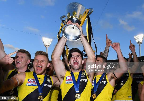 Trent Cotchin of the Tigers holds up the Premiership Trophy after winning the 2017 AFL Grand Final match between the Adelaide Crows and the Richmond...