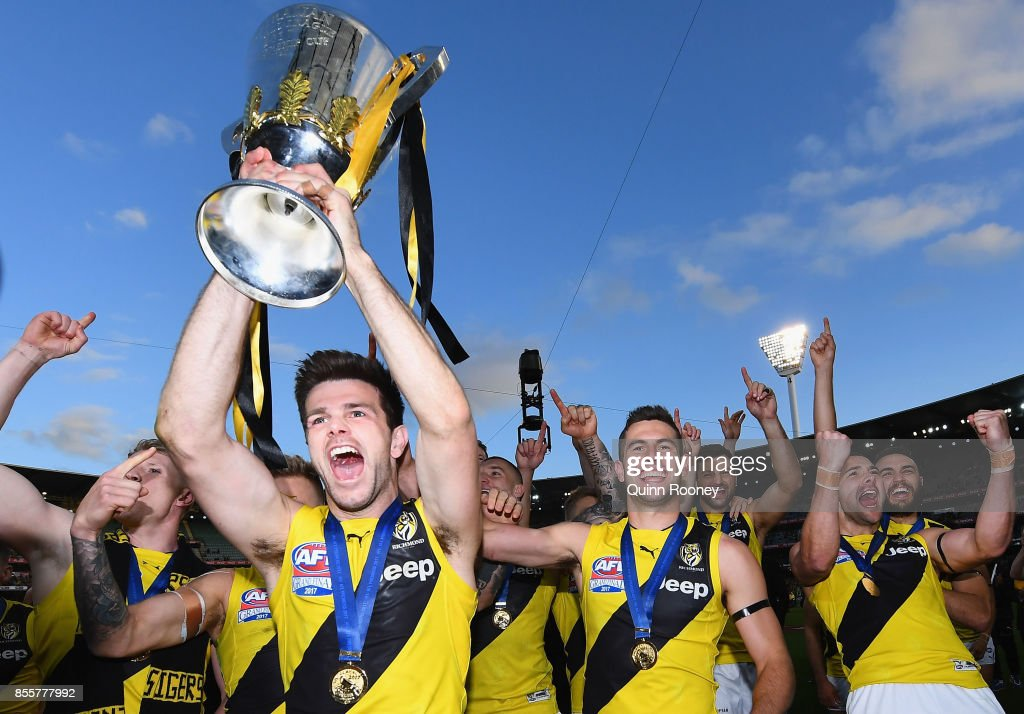 Trent Cotchin of the Tigers holds up the Premiership Trophy after winning the 2017 AFL Grand Final match between the Adelaide Crows and the Richmond Tigers at Melbourne Cricket Ground on September 30, 2017 in Melbourne, Australia.