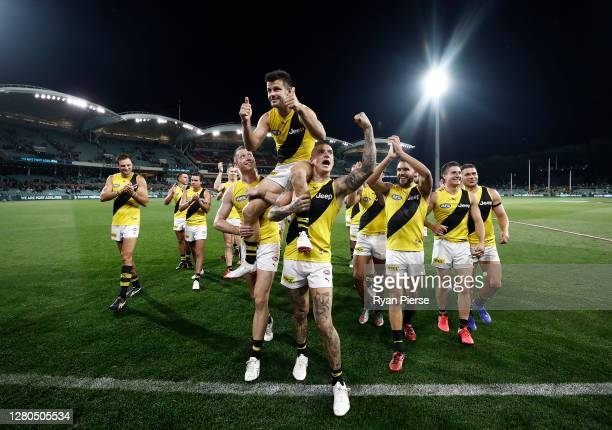 Trent Cotchin of the Tigers is chaired off by Dustin Martin of the Tigers after the Tigers defeated the Power and playing his 250th match during the...