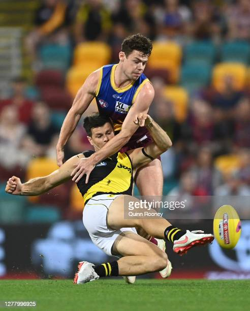 Trent Cotchin of the Tigers is challenged Lachie Neale of the Lions during the AFL Second Qualifying Final match between the Brisbane Lions and the...