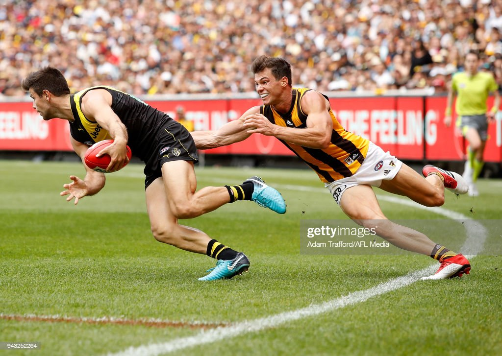 Trent Cotchin of the Tigers is tackled by Jaeger OâMeara of the Hawks during the 2018 AFL round 03 match between the Richmond Tigers and the Hawthorn Hawks at the Melbourne Cricket Ground on April 8, 2018 in Melbourne, Australia.