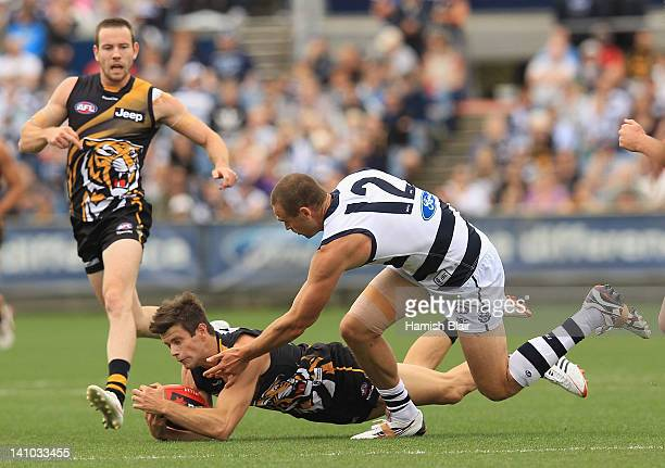 Trent Cotchin of the Tigers is tackled by Trent West of the Cats during the round three AFL NAB Cup match between the Geelong Cats and the Richmond...