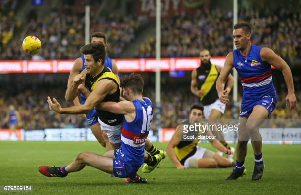 Trent Cotchin of the Tigers is tackled during the round seven AFL match between the Western Bulldogs and the Richmond Tigers at Etihad Stadium on May...