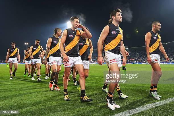 Trent Cotchin of the Tigers leads the team off after defeat during the round 11 AFL match between the North Melbourne Kangaroos and the Richmond...