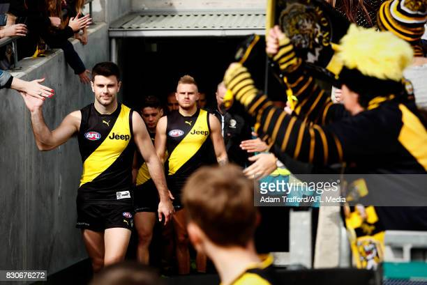 Trent Cotchin of the Tigers leads the team up the race during the 2017 AFL round 21 match between the Geelong Cats and the Richmond Tigers at Simonds...