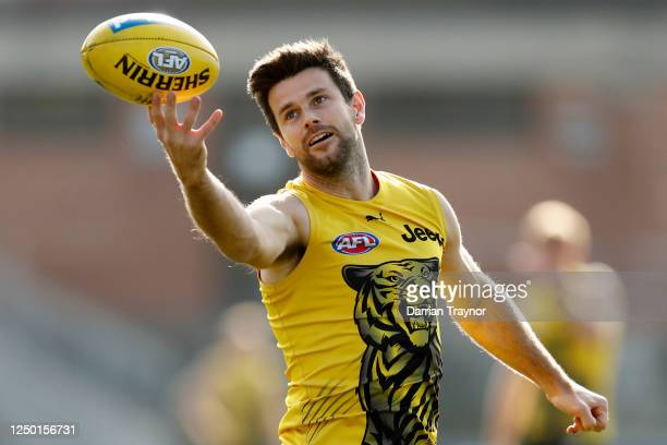 Trent Cotchin of the Tigers marks the ball during a Richmond Tigers AFL training session at Punt Road Oval on June 17 2020 in Melbourne Australia