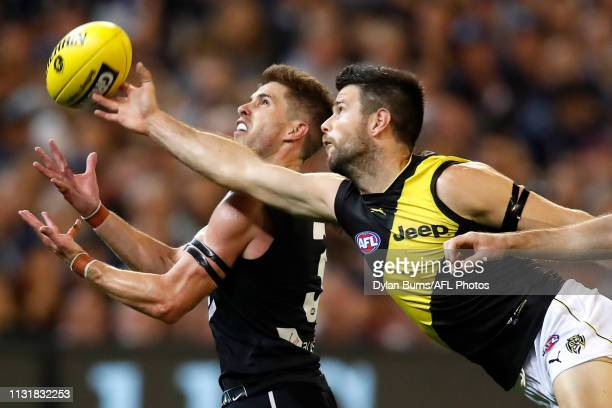Trent Cotchin of the Tigers spoils ahead of Marc Murphy of the Blues during the 2019 AFL round 01 match between the Carlton Blues and the Richmond...