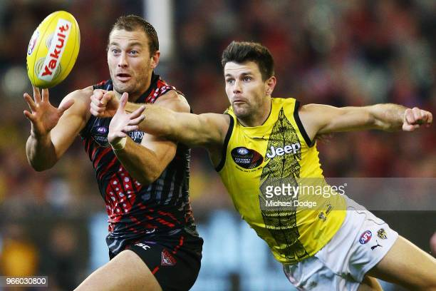 Trent Cotchin of the Tigers spoils Tom Bellchambers of the Bombers during the round 11 AFL match between the Essendon Bombers and the Richmond Tigers...
