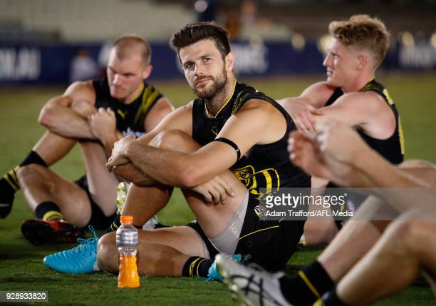 Trent Cotchin of the Tigers stretches after the AFL 2018 JLT Community Series match between the Richmond Tigers and the North Melbourne Kangaroos at...
