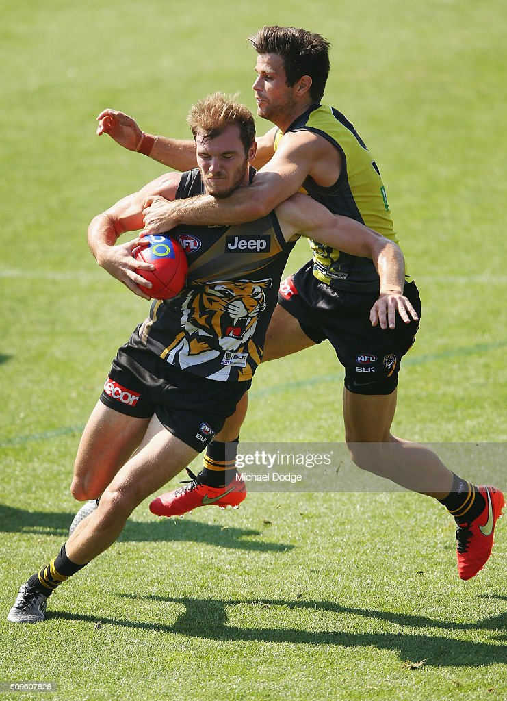 Trent Cotchin of the Tigers tackles high Kamdyn McIntosh of the Tigers during the Richmond Tigers AFL intra-club match at Punt Road Oval on February 12, 2016 in Melbourne, Australia.