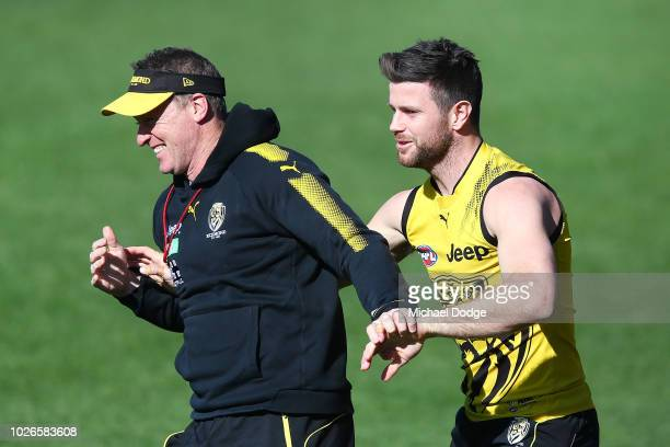 Trent Cotchin of the Tigers tackles Tigers head coach Damien Hardwick during a Richmond Tigers AFL training session at Punt Road Oval on September 4,...