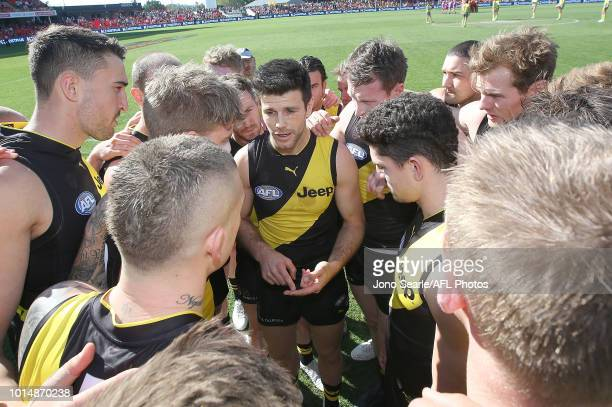 Trent Cotchin of the Tigers talks to his team during the round 21 AFL match between the Gold Coast Suns and the Richmond Tigers at Metricon Stadium...