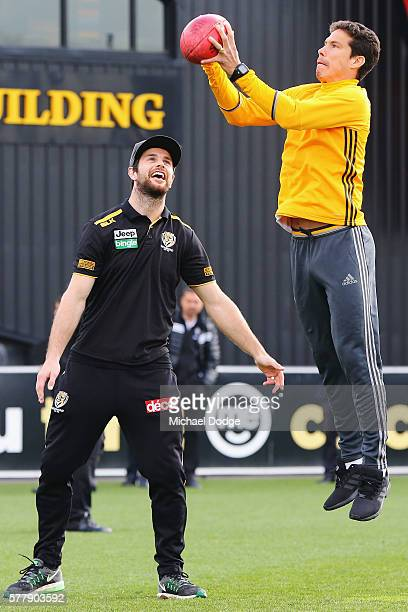 Trent Cotchin of the Tigers watches Hernanes of Juventus mark an AFL football during a Richmond Tigers AFL and Juventus FC media opportunity at Punt...