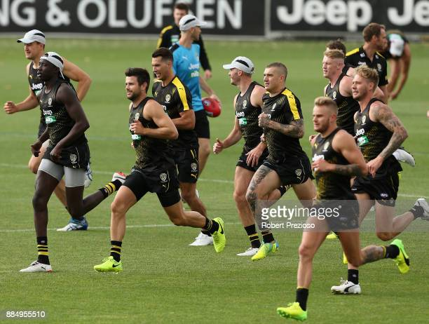 Trent Cotchin runs during a Richmond Tigers AFL training session at Punt Road Oval on December 4 2017 in Melbourne Australia