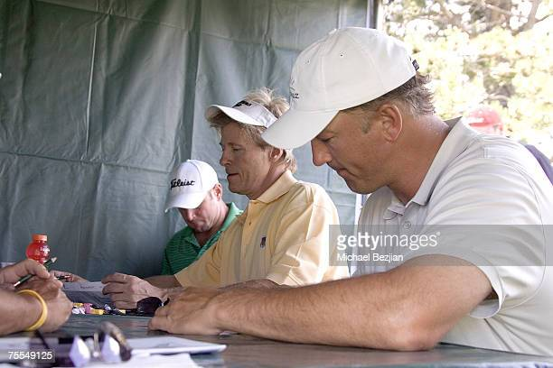 Trent Dilfer Jack Wagner and Winner Chris Chandler sign autographs at the American Century Celebrity Golf Tournament at the Edgewood Tahoe Golf...