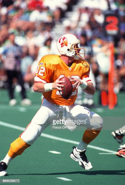 Trent Dilfer of the Tampa Bay Buccaneers drops back to pass against the Philadelphia Eagles during an NFL football game September 3 1995 at Veterans...