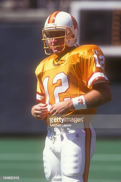 Trent Dilfer of the Tampa Bay Buccaneers looks on before a football game against the Philadelphia Eagles on September 3 1995 at Veterans Stadium in...