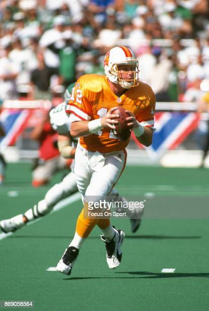 Trent Dilfer of the Tampa Bay Buccaneers looks to pass against the Philadelphia Eagles during an NFL football game September 3 1995 at Veterans...